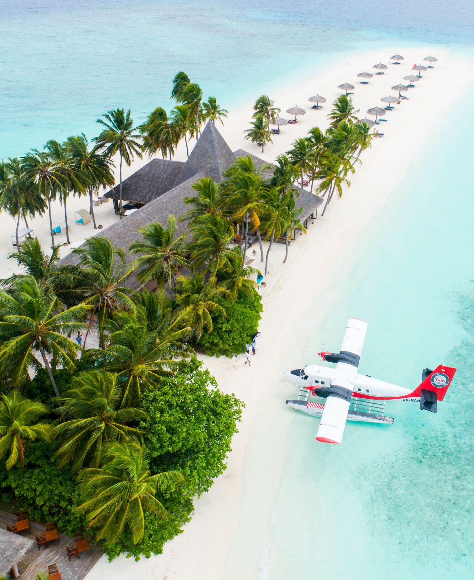 Aerial view of a seaplane parked at a resort on a Maldives island on SelfishMe Travel LLC