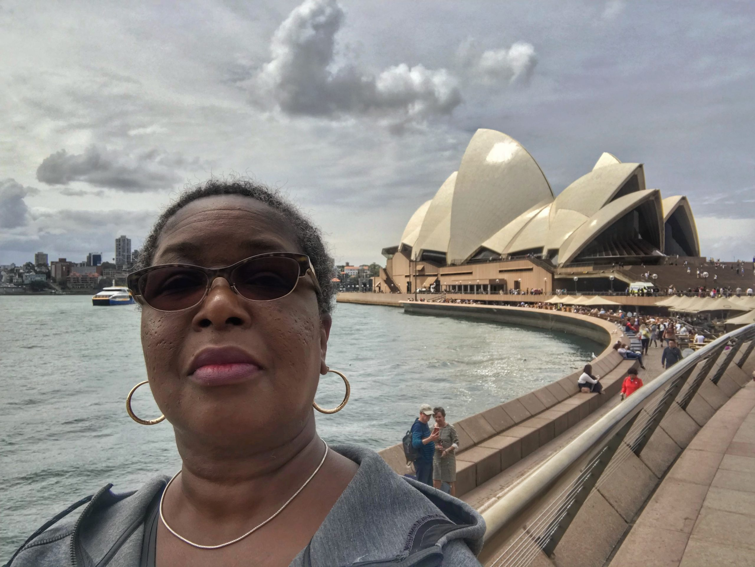 Danielle Lewis, owner of SelfishMe Travel LLC, at the Sydney Opera House in Sydney, Australia - image taken with an iPhone 7