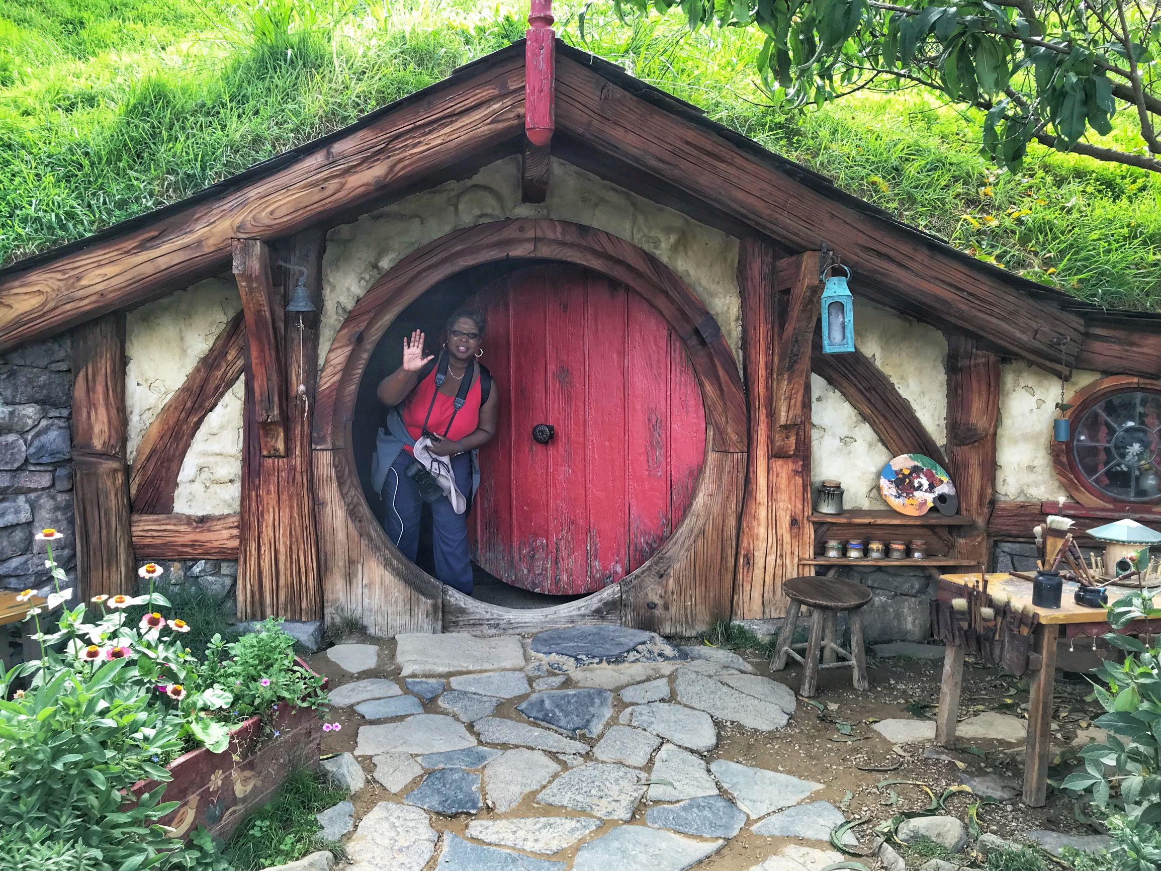 Danielle Lewis, owner of SelfishMe Travel LLC at the Hobbiton Movie Set in Matamata, New Zealand - image taken with an iPhone 7